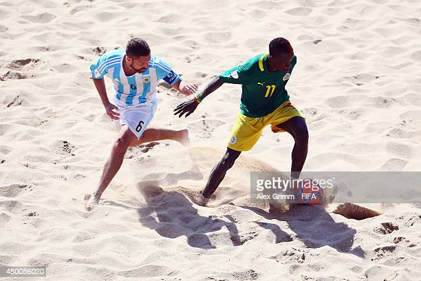 Luciano Franceschini of Argentina is challenged by Ibrahima Balde of Senegal during the FIFA Beach Soccer World Cup Portugal 2015 Group A match...
