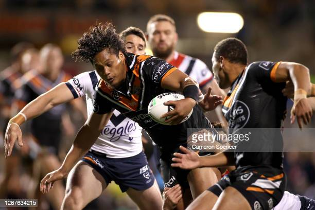 Luciano Leilua of the Tigers charges forward during the round 15 NRL match between the Wests Tigers and the Sydney Roosters at Leichhardt Oval on...