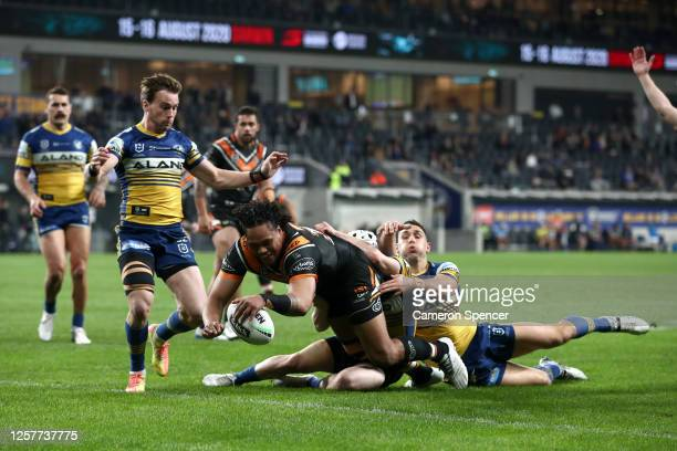 Luciano Leilua of the Tigers scores a try during the round 11 NRL match between the Parramatta Eels and the Wests Tigers at Bankwest Stadium on July...