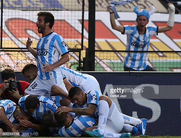 Luciano Lollo of Racing Club celebrates with teammates after scoring the first goal of his team during a second leg match between Independiente and...