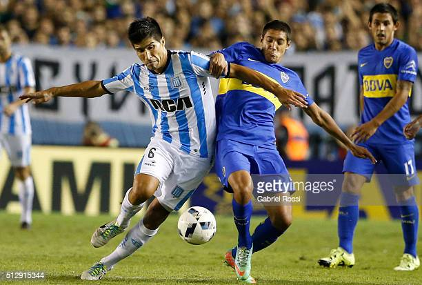 Luciano Lollo of Racing Club fights for the ball with Nahuel Molina Lucero of Boca Juniors during a fifth round match between Racing Club and Boca...