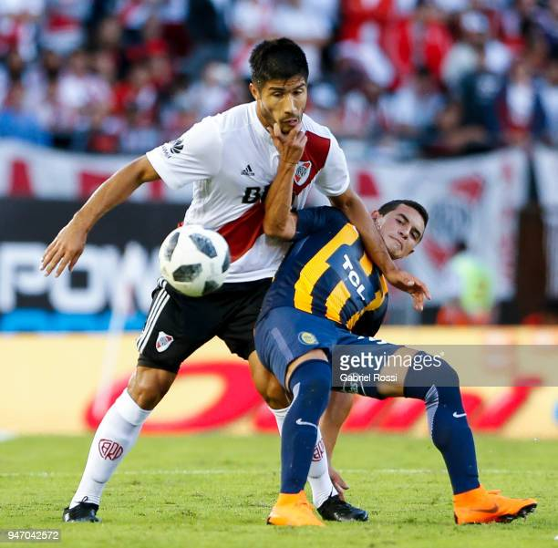 Luciano Lollo of River Plate fights for the ball with Joaquin Pereyra of Rosario Central during a match between River Plate and Rosario Central as...