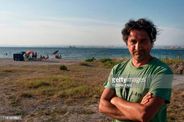 Luciano Manna member of the association 'Peacelink' speaks about the environmental impact of the exilva steel plant in the city of Taranto on July 22...