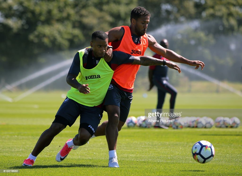 Luciano Narsingh challenged by Wayne Routledge during the Swansea City Training at The Fairwood Training Ground on July 5, 2017 in Swansea, Wales.
