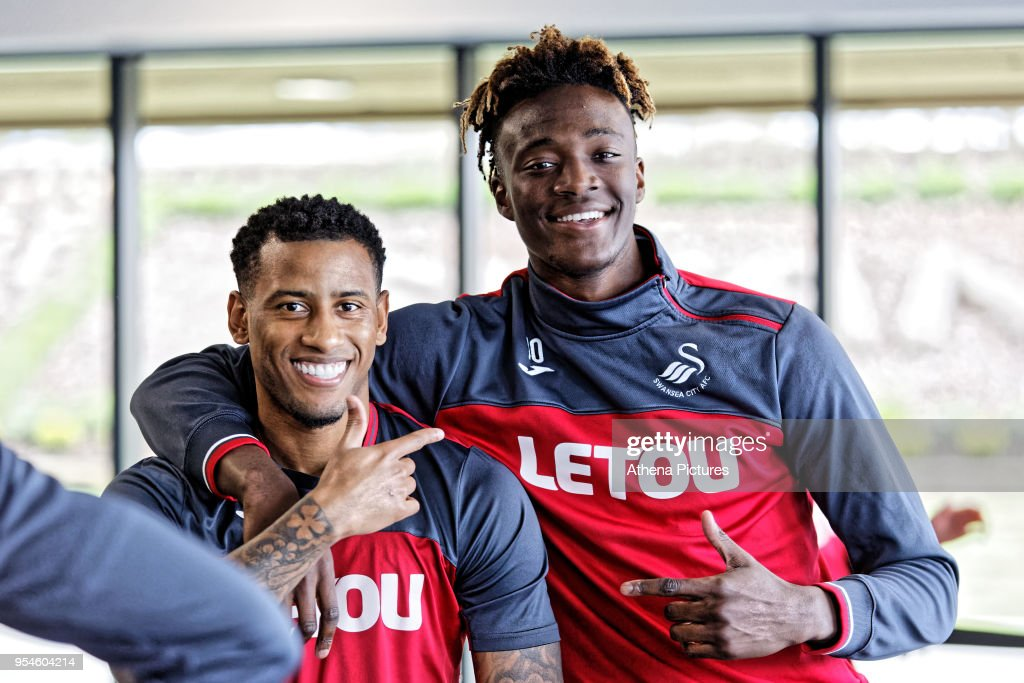 Luciano Narsingh is embraced by Tammy Abraham in the gym during the Swansea City Training at The Fairwood Training Ground on May 02, 2018 in Swansea, Wales.