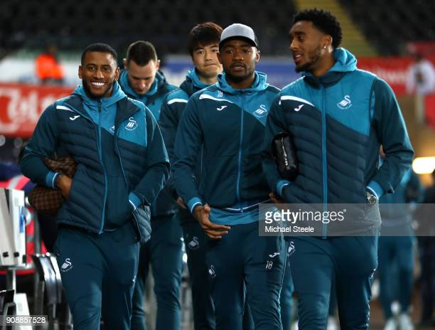 Luciano Narsingh Jordan Ayew and Leroy Fer of Swansea City arrive prior to the Premier League match between Swansea City and Liverpool at Liberty...