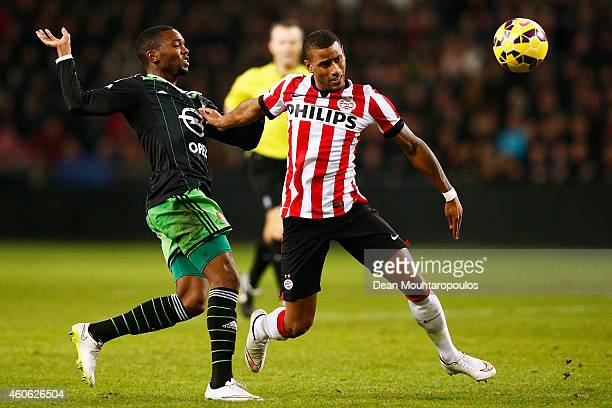 Luciano Narsingh of PSV and Miquel Nelom of Feyenoord battle for the ball during the Eredivisie match between PSV Eindhoven and Feyenoord Rotterdam...