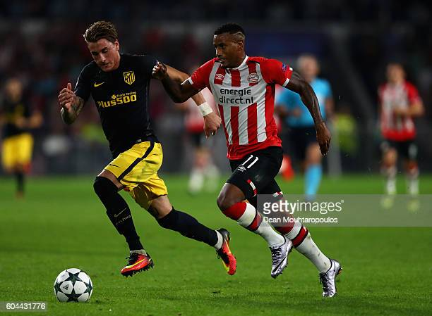 Luciano Narsingh of PSV Eindhoven and José Gimenez of Atletico Madrid in action during the UEFA Champions League Group D match between PSV Eindhoven...