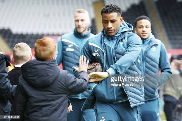 Luciano Narsingh of Swansea arrives at Liberty Stadium prior to kick off of the Fly Emirates FA Cup Quarter Final match between Swansea City and...
