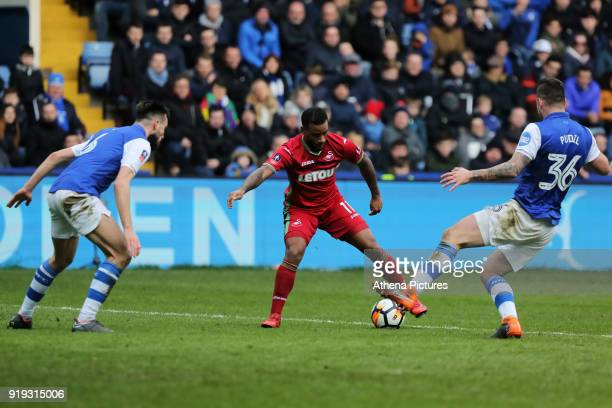 Luciano Narsingh of Swansea City against Morgan Fox and Daniel Pudil of Sheffield Wednesday during The Emirates FA Cup Fifth Round match between...