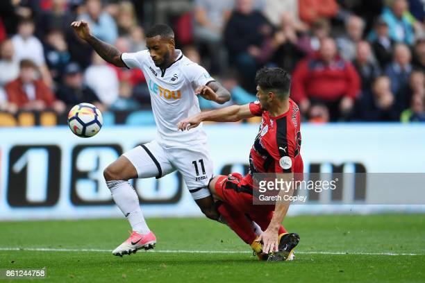 Luciano Narsingh of Swansea City and Christopher Schindler of Huddersfield Town battle for possession during the Premier League match between Swansea...