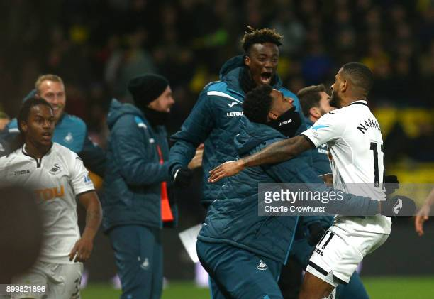 Luciano Narsingh of Swansea City celebrates scoring his team's second goal with team mates during the Premier League match between Watford and...