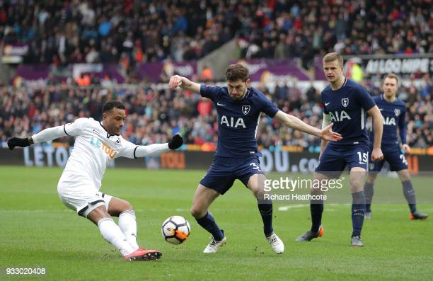 Luciano Narsingh of Swansea City crosses the ball under pressure from Ben Davies of Tottenham Hotspur during The Emirates FA Cup Quarter Final match...
