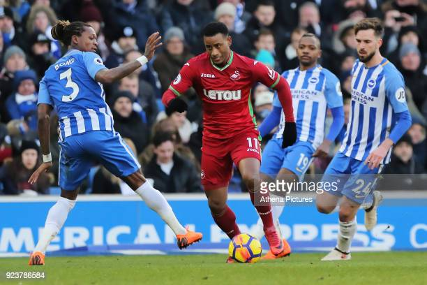 Luciano Narsingh of Swansea City gets past Gaetan Bong and another two Broghton players during the Premier League match between Brighton and Hove...