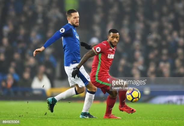 Luciano Narsingh of Swansea City holds off Gylfi Sigurdsson of Everton during the Premier League match between Everton and Swansea City at Goodison...