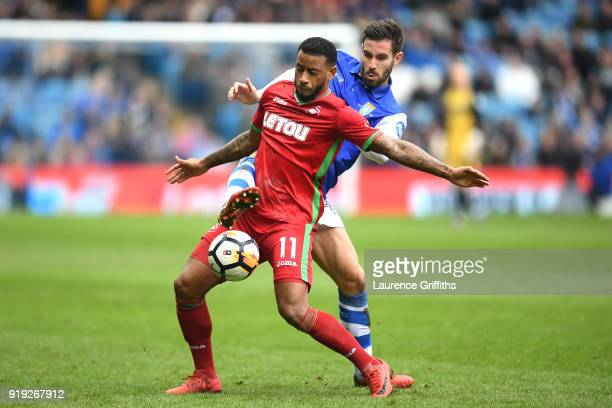 Luciano Narsingh of Swansea City is challenged by Frederico Venâncio of Sheffield Wednesday during the The Emirates FA Cup Fifth Round between...