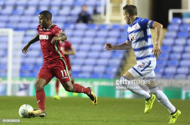 Luciano Narsingh of Swansea City is pursued by Chris Gunter of Reading during the Carabao Cup Third Round match between Reading and Swansea City at...