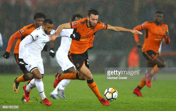 Luciano Narsingh of Swansea City is tackled by Roderick Miranda of Wolverhampton Wanderers during The Emirates FA Cup Third Round Replay between...