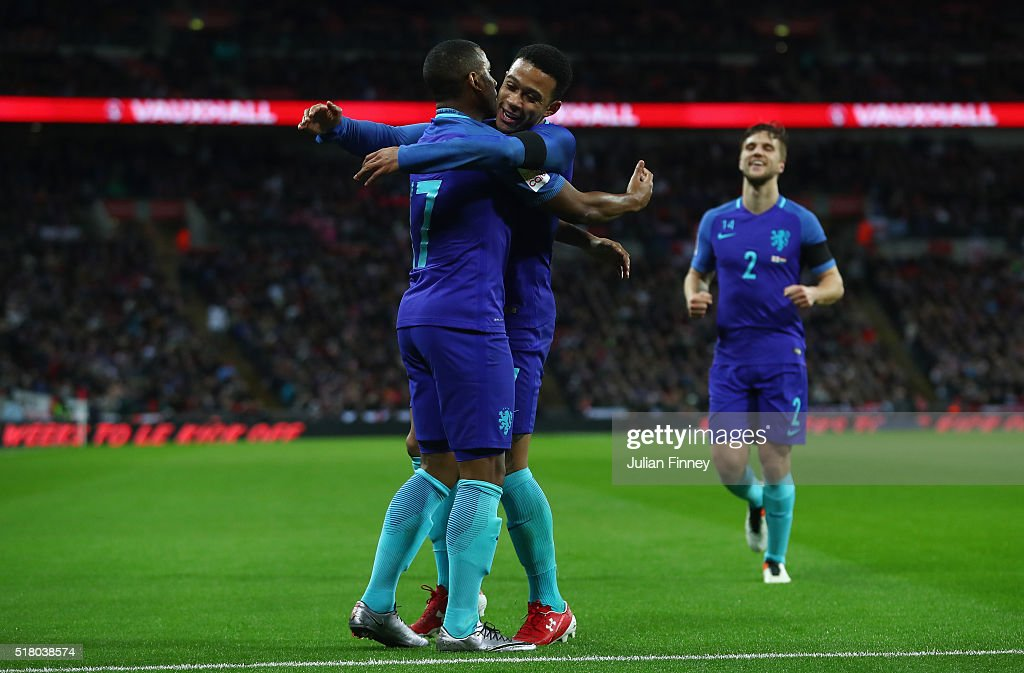 Luciano Narsingh (l) of the Netherlands celebrates scoring his sides second goal with Memphis Depay during the International Friendly match between England and Netherlands at Wembley Stadium on March 29, 2016 in London, England.