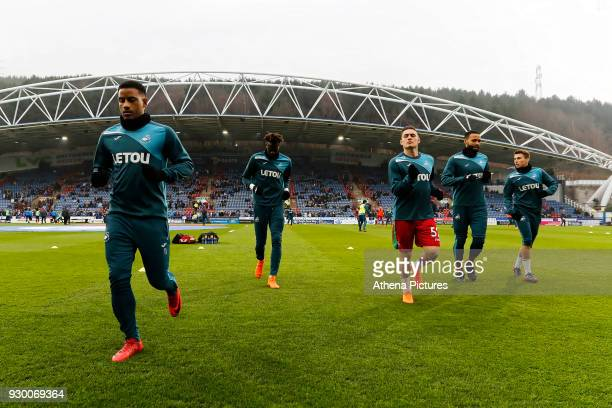 Luciano Narsingh Tammy Abraham and Connor Roberts Kyle Bartley and Tom Carroll of Swansea City warm up prior to the game during the Premier League...