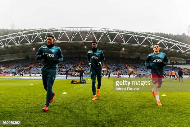 Luciano Narsingh Tammy Abraham and Connor Roberts of Swansea City warm up prior to the game during the Premier League match between Huddersfield Town...