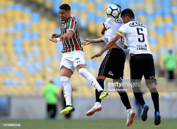 Luciano of Fluminense struggles for the ball with Matheus Fernandes and Rodrigo Lindoso of Botafogo during a match between Fluminense and Botafogo as...