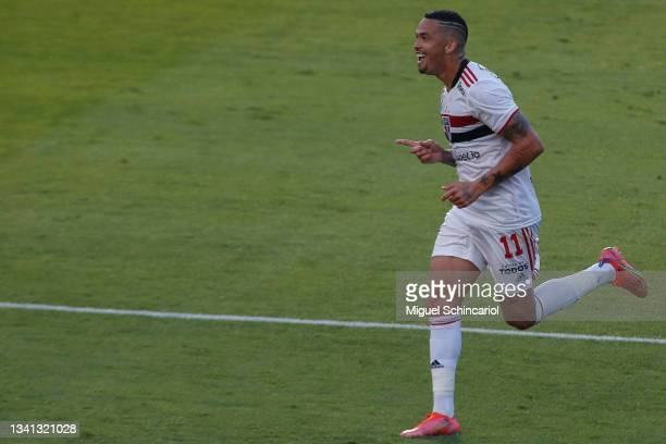 Luciano of Sao Paulo celebrates after scoring his team second goal during a match between Sao Paulo and Atletico Goianiense as part of Brasileirao...