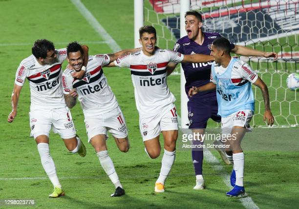 Luciano of Sao Paulo celebrates with his teammates after scoring the first goal of their team during the match against Coritiba as part of of...