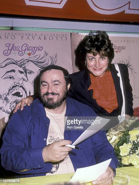 Luciano Pavarotti and Adua Veroni during Luciano Pavarotti Autographs Copies of the Soundtrack to Yes Giorgio at Sam Goody Store in New York City New...