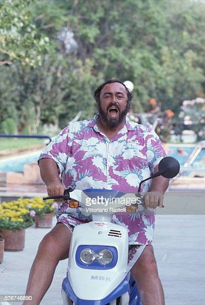 Luciano Pavarotti rides a motorcycle at his villa in Pesaro