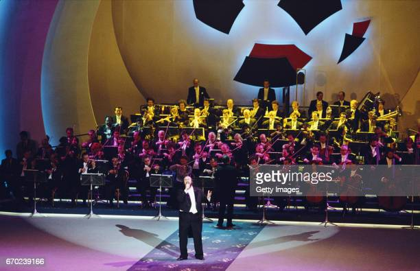 Luciano Pavarotti sings at the 1990 FIFA World Cup Draw at the Palazzetto dello Sport in Rome, Italy on December 9, 1989.