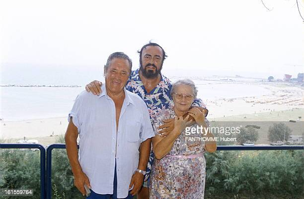 Luciano Pavarotti With Family In Pesaro Luciano Pavarotti on vacation at his home in Pesaro on the Adriatic Sea He poses with his parents Fernando...