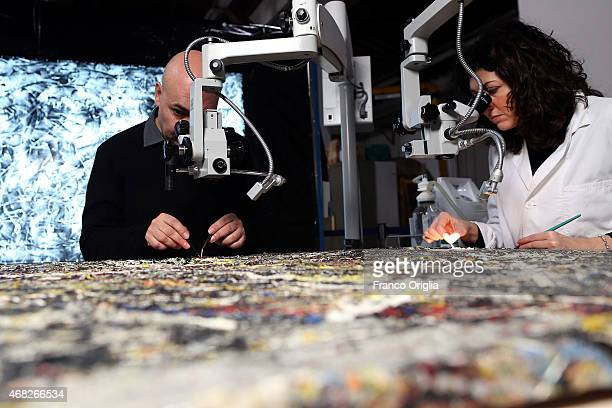 Luciano Pensabene the conservator of the Peggy Guggenheim Collection in Venice and Francesca Betteni restore 'Alchemy' by Jackson Pollock at the...