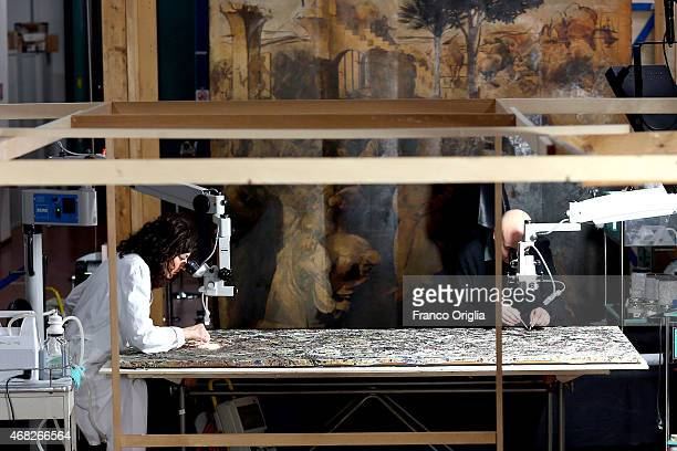 Luciano Pensabene the conservator of the Peggy Guggenheim Collection in Venice and Francesca Betteni restore 'Alchemy' by Jackson Pollock on the...