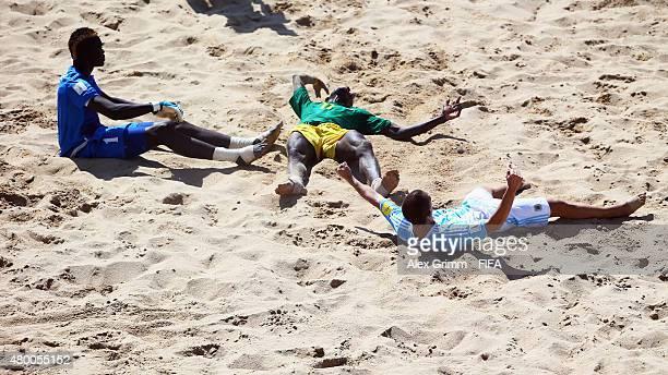 Luciano Sirico of Argentina celebrates his team's third goal as goalkeeper Al Seyni Ndiaye and Ibrahima Balde of Senegal react during the FIFA Beach...