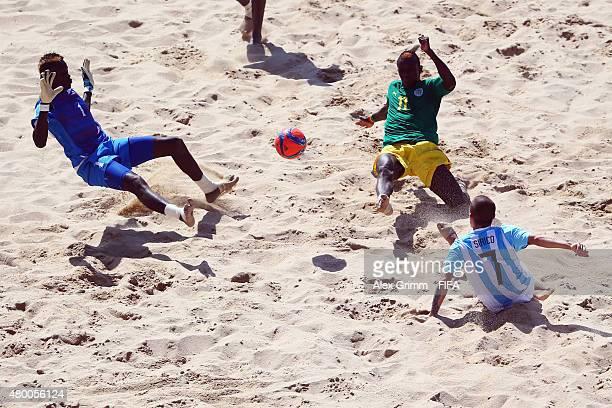 Luciano Sirico of Argentina scores his team's third goal against goalkeeper Al Seyni Ndiaye and Ibrahima Balde of Senegal during the FIFA Beach...