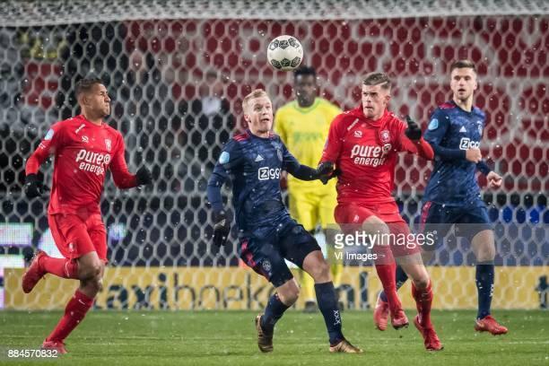 Luciano Slagveer of FC Twente Donny van de Beek of Ajax Marko Kvasina of FC Twente during the Dutch Eredivisie match between FC Twente Enschede and...
