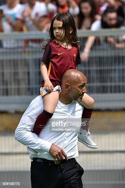 Luciano Spalletti Coach AS Roma carries a girl on his shoulders after winning the Italian Serie A soccer match between AS Roma and AC Chievo Verona...