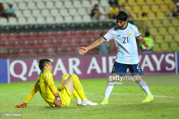 Luciano Vera of Argentina helps Shohrukh Qirghizboev of Tajikistan up after a goal was scored against him during the FIFA U17 World Cup Brazil 2019...