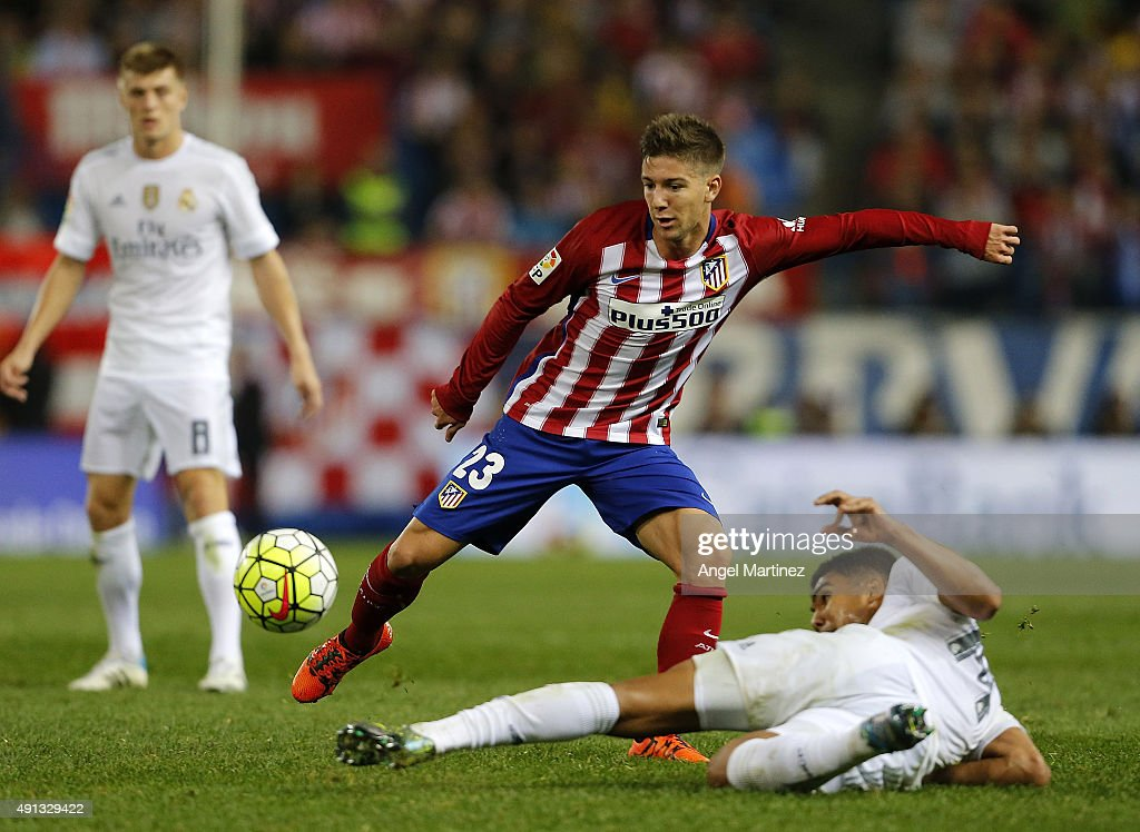 Luciano Vietto of Atletico de Madrid competes for the ball with Casemiro of Real Madrid during the La Liga match between Club Atletico de Madrid and Real Madrid CF at Vicente Calderon Stadium on October 4, 2015 in Madrid, Spain.