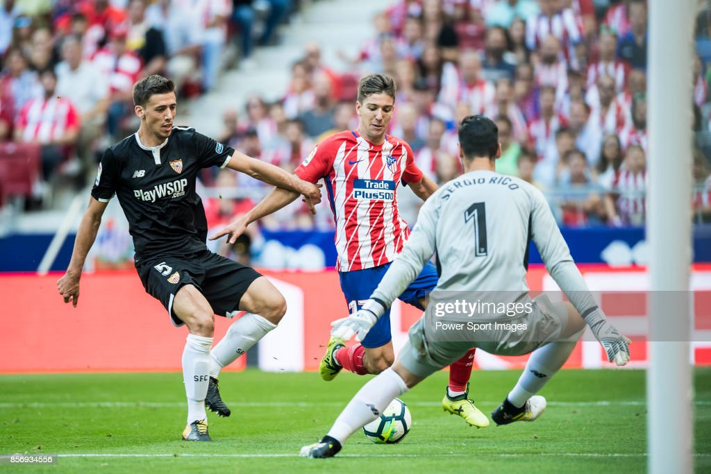Luciano Vietto (r) of Atletico de Madrid fights for the ball with Clement Nicolas Laurent Lenglet of Sevilla FC during the La Liga 2017-18 match between Atletico de Madrid and Sevilla FC at the Wanda Metropolitano on 23 September 2017 in Madrid, Spain.