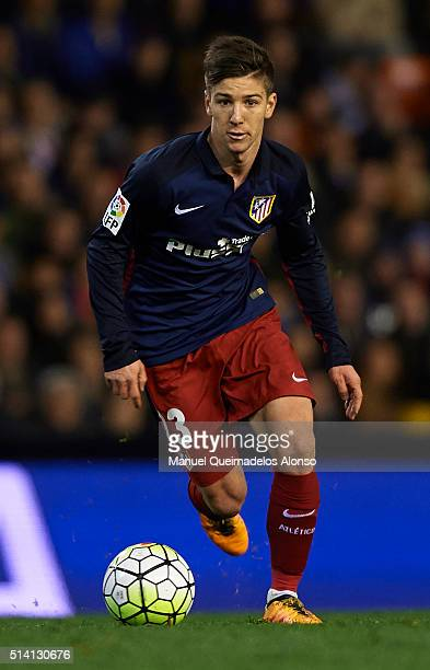 Luciano Vietto of Atletico de Madrid runs with the ball during the La Liga match between Valencia CF and Atletico de Madrid at Estadi de Mestalla on...