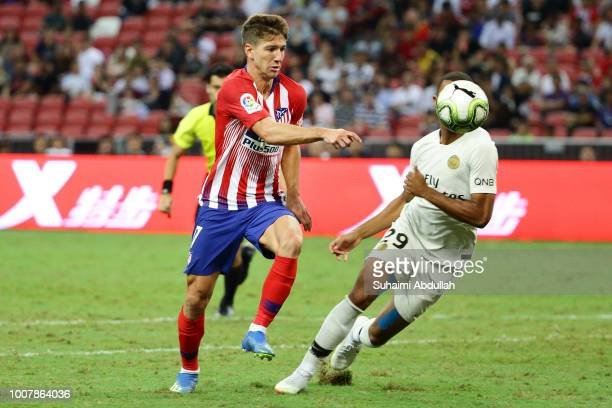 Luciano Vietto of Atletico Madrid and Antoine Bernede of Paris Saint Germain chase for the ball during the International Champions Cup 2018 match...