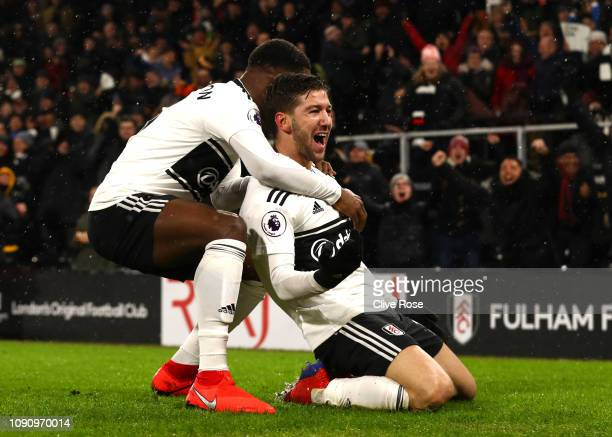 Luciano Vietto of Fulham celebrates after scoring his team's fourth goal Ryan Sessegnon of Fulham during the Premier League match between Fulham and...