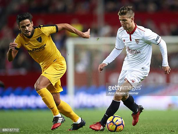 Luciano Vietto of Sevilla FC being followed by Jose Luis Garcia 'Recio' of Malaga CF during the La Liga match between Sevilla FC and Malaga CF at...