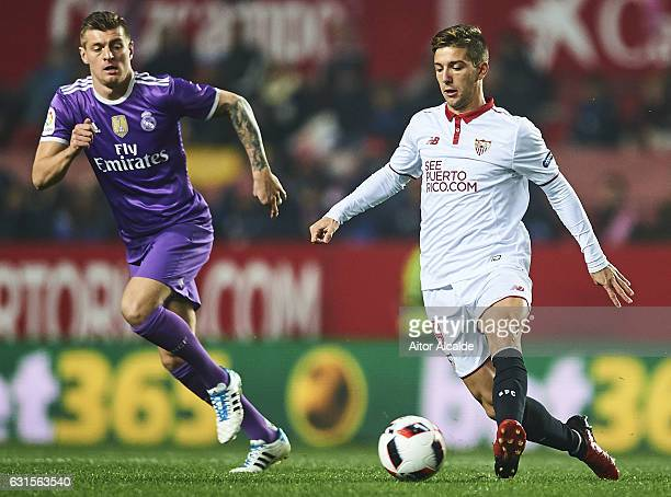 Luciano Vietto of Sevilla FC being followed by Toni Kroos of Real Madrid CF during the Copa del Rey Round of 16 Second Leg match between Sevilla FC...