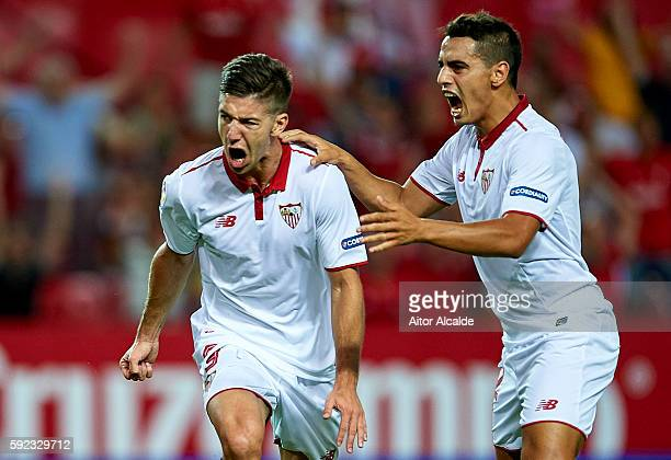 Luciano Vietto of Sevilla FC celebrates after scoring with his team mate Wissam Ben Yedder of Sevilla FC during the match between Sevilla FC vs RCD...