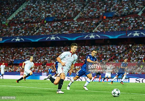 Luciano Vietto of Sevilla FC in action during the UEFA Champions League match between Sevilla FC and Olympique Lyonnais at Sanchez Pizjuan stadium on...