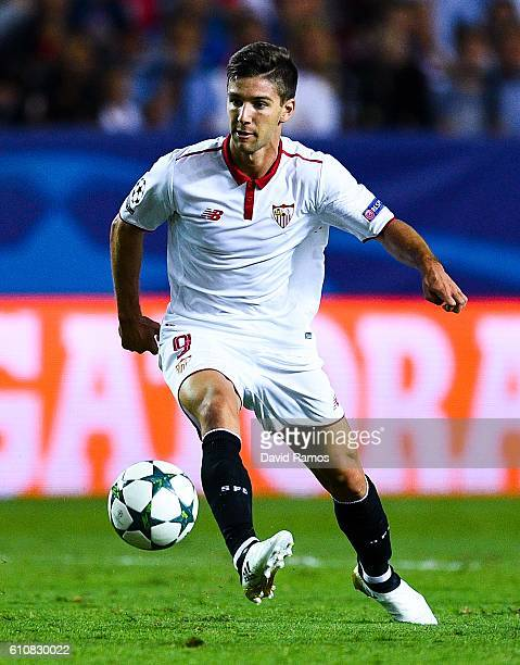 Luciano Vietto of Sevilla FC runs with the ball during the UEFA Champions League Group H match between Sevilla FC and Olympique Lyonnais at the Ramon...