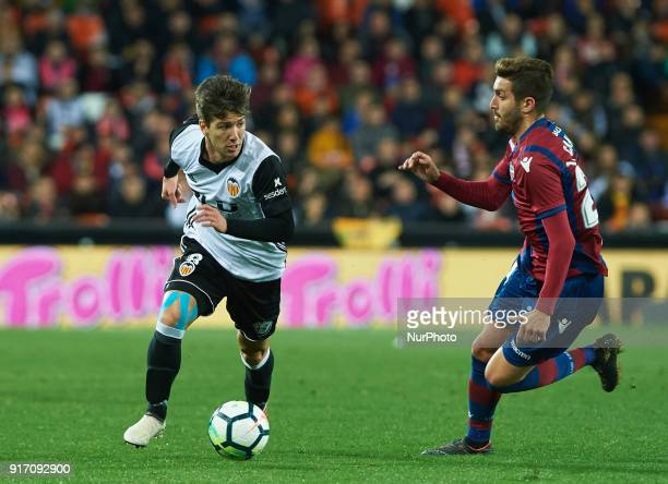 Luciano Vietto of Valencia CF and Jose Gomez Campana of Levante during the La Liga match between Valencia CF and Levante at Mestalla Estadium on...